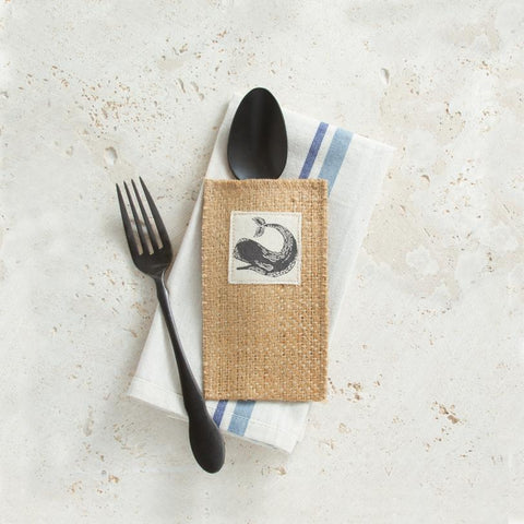 A vintage whale from the deep blue sea brings a sense of whimsy to your table; a taste of summer all year long
