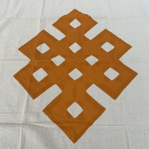 table cloth square endless knot dark yellow close up