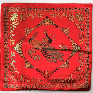 Cushion red with peacocks imitation silk front without cushion