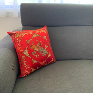 Cushion red with peacocks imitation silk lounge example