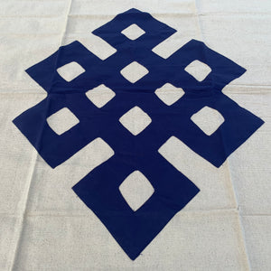 Table cloth square dark blue endless knot close up