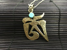 Load image into Gallery viewer, OM shaped silver pendant with turquoise