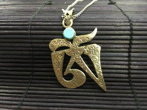 OM shaped silver pendant with turquoise