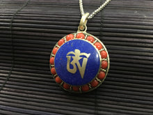 Load image into Gallery viewer, OM silver round pendant with red coral & lapis lazuli
