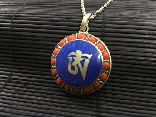 OM silver round pendant with red coral & lapis lazuli