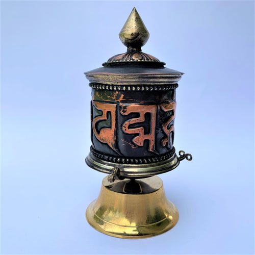 prayer wheel standing sanskrit mani front