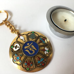 Key Chain: Golden OM round with Eight Auspicious Symbols front