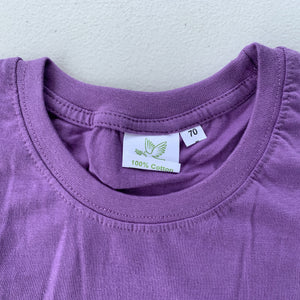 children's tshirt purple with Tibetan musician design size tag