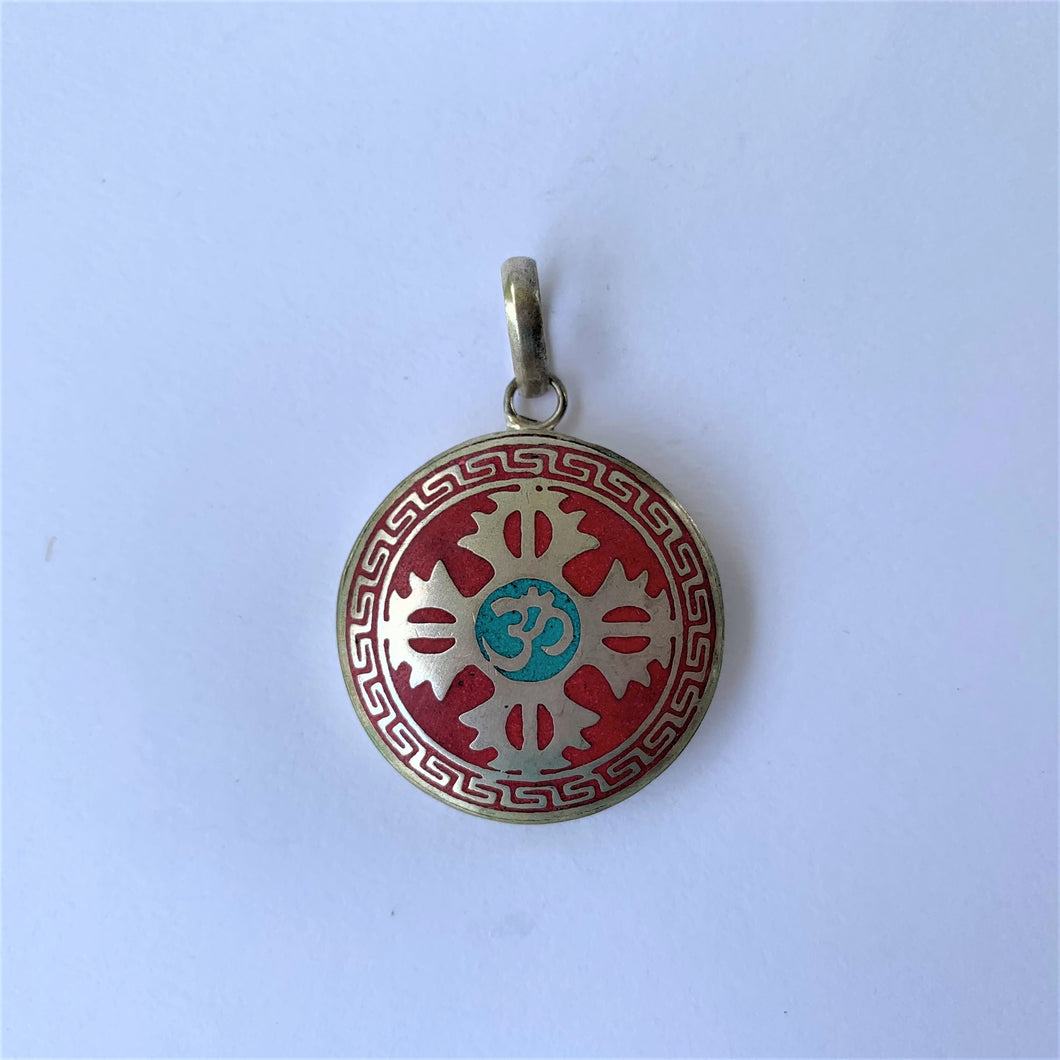 pendant round double dorje on red background with OM syllable