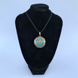 pendant round with OM syllable with lapis lazuli & turquoise on bust