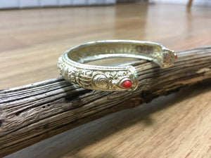 Silver bracelet with red coral and vajra design