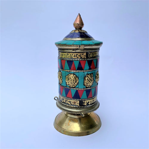 prayer wheel standing stoene patched front