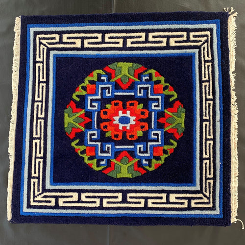 tibetan carpet: dark blue front