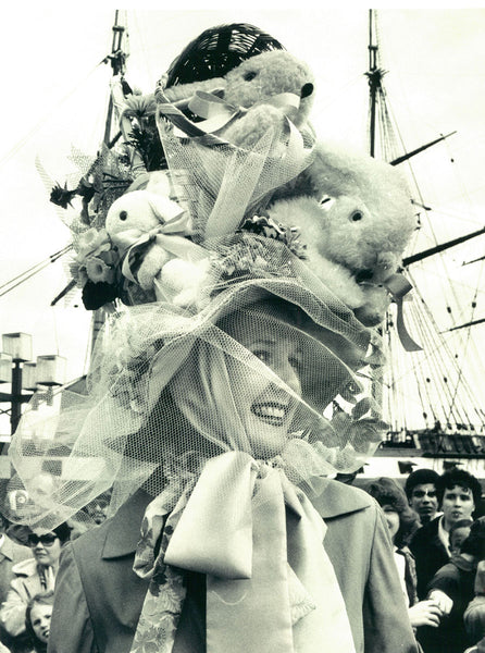 Woman with large easter bonnet hat with rabbits and eggs