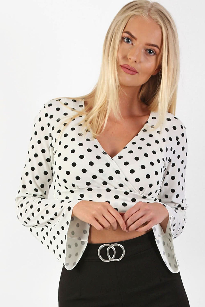 Polka Dot Long Flare Sleeve Wrap Crop Top in White 1