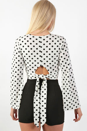 Polka Dot Long Flare Sleeve Wrap Crop Top in White 2