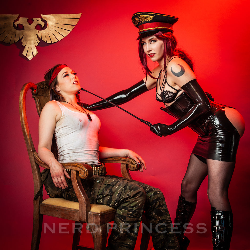 Nerd Princess cosplays as a sexy dominatrix version of a warhammer 40k Commissar