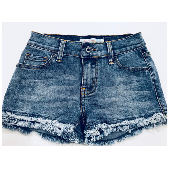 Vintage havana tween girl's medium wash denim shorts with double frey hem.