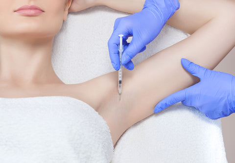 Woman receiving botox in her armpit for hyperhidrosis