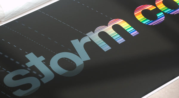 Close up of typography illustrating a storm turning into a rainbow