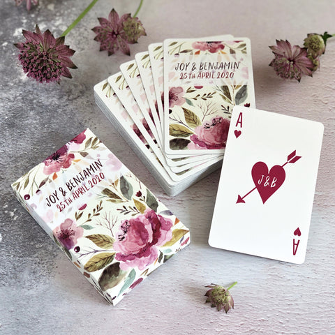 Personalised playing card wedding favours with a floral design