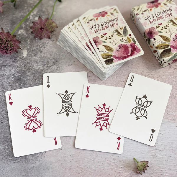 Playing card wedding favours for a floral theme wedding