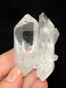quartz crystal double point cluster shown in hand for size