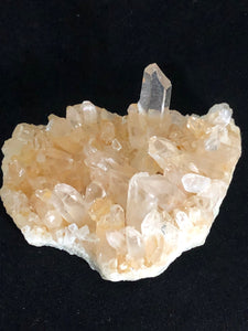 quartz crystal cluster with golden hue
