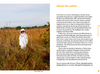 Beekeeper author Orren Fox wearing bee suit standing in a field