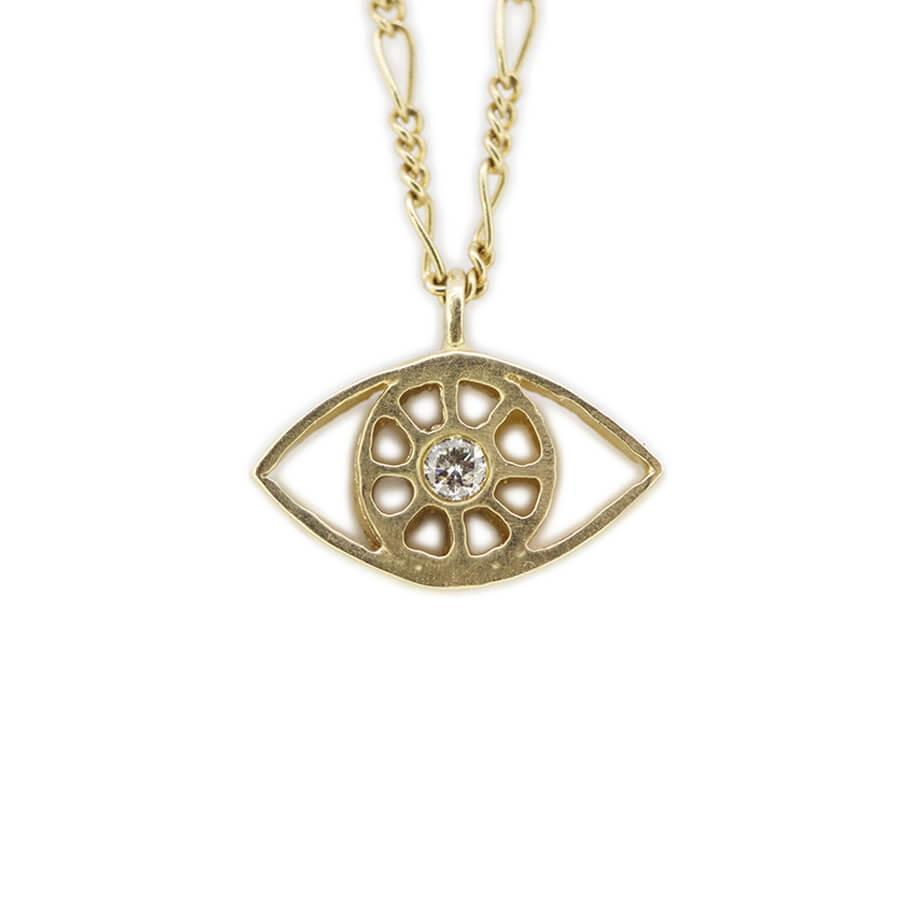 Gold evil eye necklace.