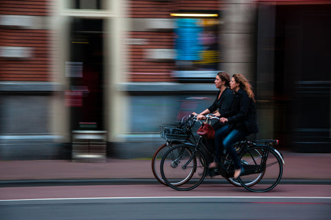 Friends riding together in Amsterdam