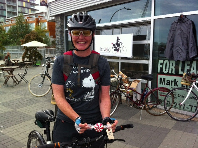 Nicole with her hand-painted bicycle bell from Le Vélo Victoria