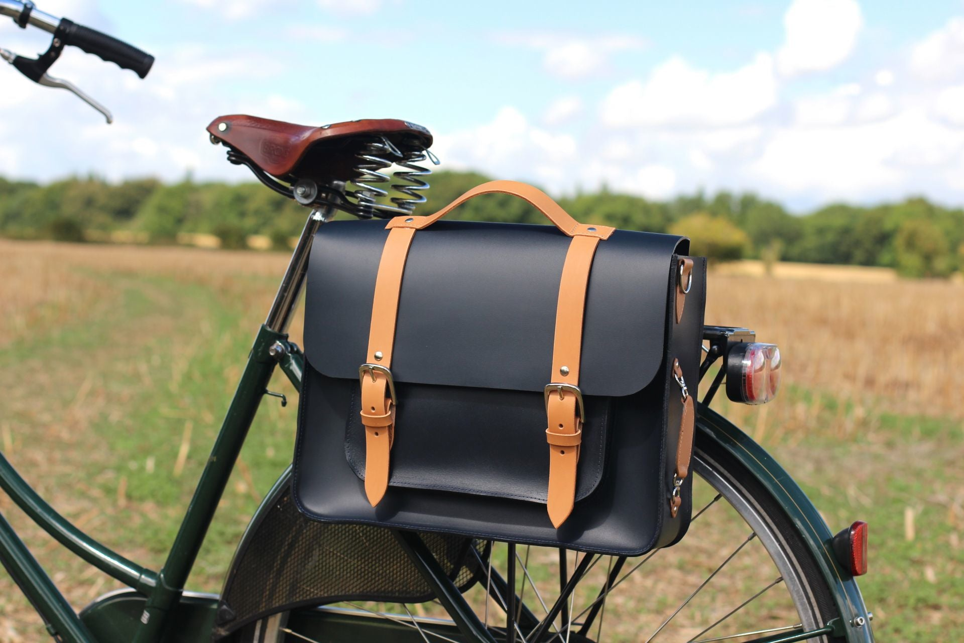 Jessica Doyle's Curated picks to discover cycling beyond summer for Le Velo Victoria Featured The Professor Leather Pannier by Hill and Ellis