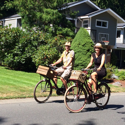 Le Vélo founder Susan and husband riding a bike