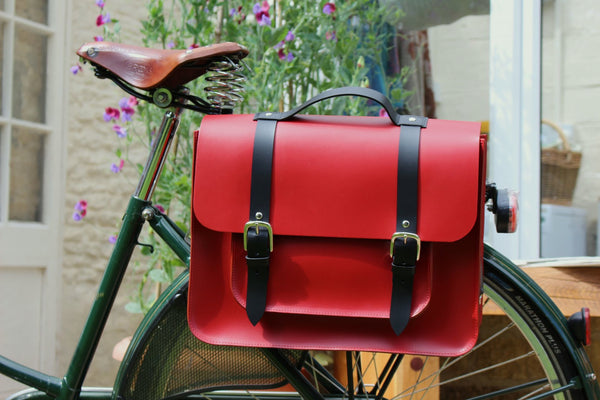 Hill anEllis Birtie Red Leather Pannier on a black bicycle