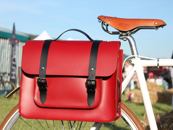 Hill anEllis Birtie Red Leather Pannier on a white bicycle