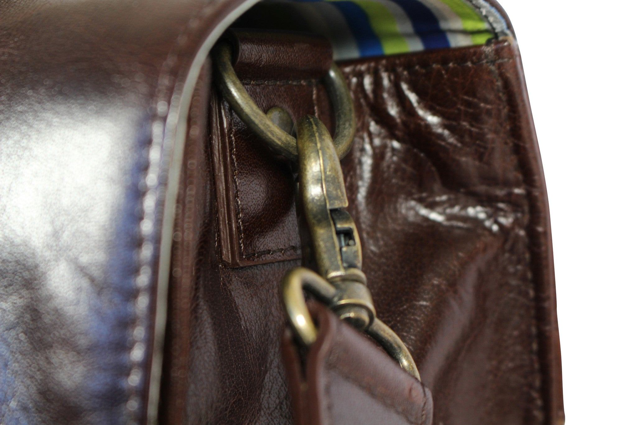 Hill and Ellis Bunbury Classic dark brown Leather Satchel view of leather strap brass attachment for the shoulder strap