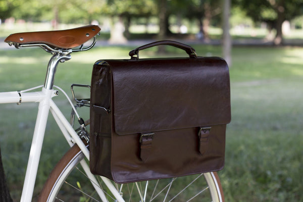 Hill and Ellis Bunbury Classic dark brown Leather Satchel on a white bicycle
