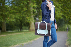 Don Dark Brown and Cambridge Blue Leather Pannier with female model carrying the pannier over her shoulder