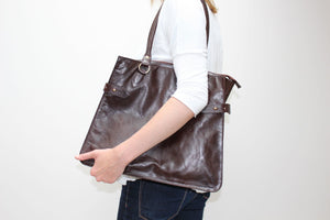 Hill and Ellis Dorothy dark brown leather pannier front with model