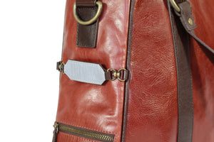 Hill and Ellis Duke Cherry Red Leather Satchel front view showing reflective strip