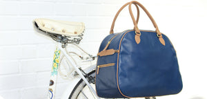 Hill and Ellis Birkdale Blue leather pannier on a bicycle