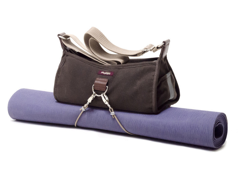 Po Campo Pilsen Bungee with yoga matt attached underneath the handbag