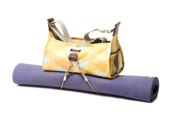 Po Campo Pilsen Bungee Handbag in feathers with yoga matt attached to the bottom of the handbag
