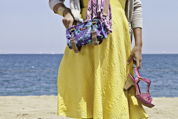 Po Campo Six Corners Wristlet purple petals over the shoulder of a model on the beach