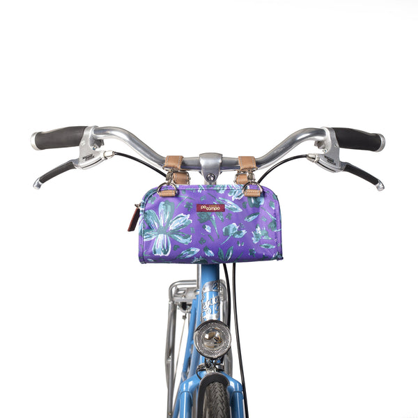 Po Campo Six Corners Wristlet purple petals on the handlebars of a bicycle