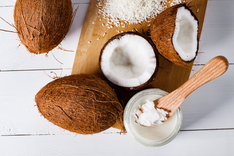 Coconuts on a white wood background
