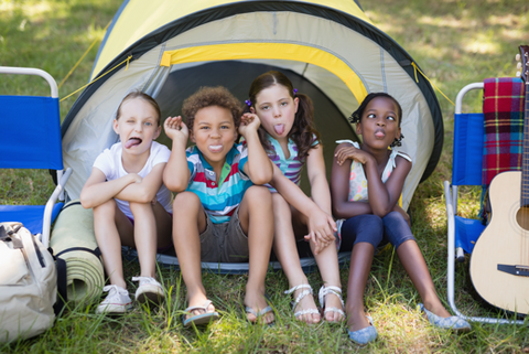 kids at summer camp, with a tent and guitar, adobe stock