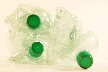 crumpled water bottles tinted green