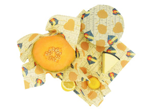 Eco-friendly Beeswax Combo Pack in action, showing how the Large, Medium, Small and Mini sizes can be used to cover bowls, fresh produce or other food stuffs such as cheese. All wraps are in the print Khalarado, which has falling aspen leaves in gold or emblazoned with the colorado flag on a background of aspen bark and the Khala & CO logo. Beeswax wraps are an excellent alternative to plastic wrap, as they are durable, long lived, and re-usable, helping you live a Zero Waste lifestyle!